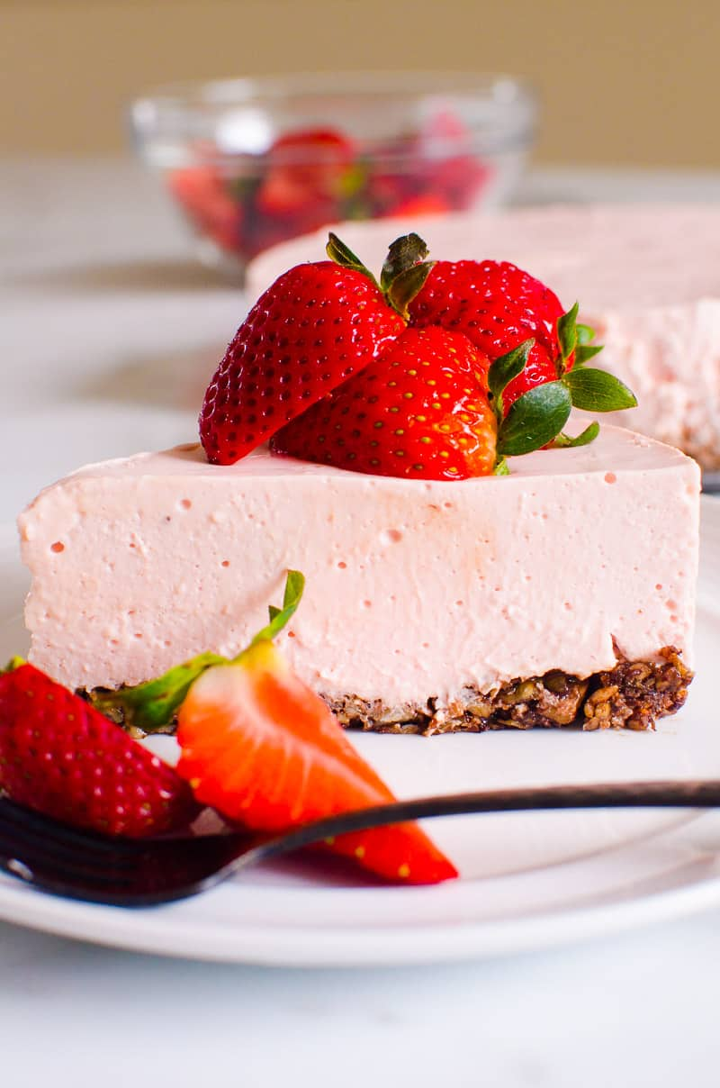 No Bake Strawberry Cheesecake slice on white plate