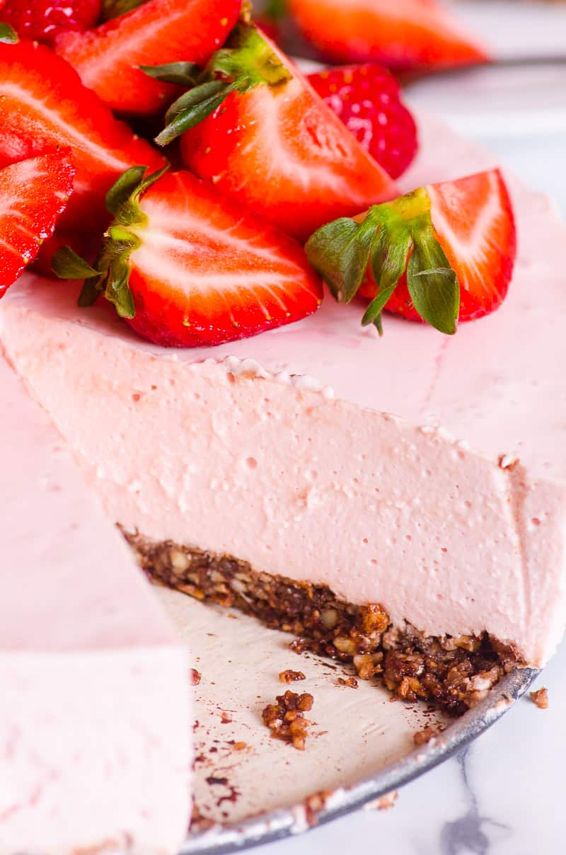 No Bake Strawberry Cheesecake sliced with strawberries on top
