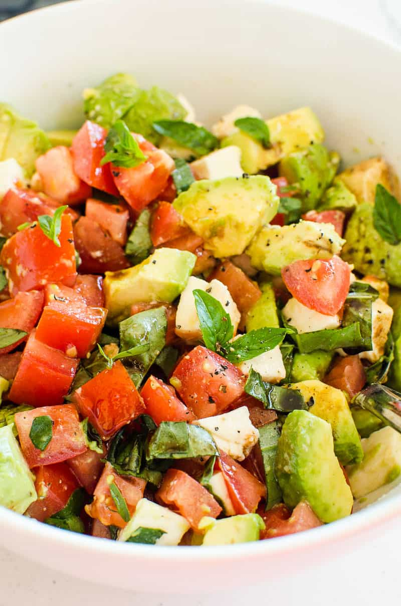 Tomato and Mozzarella Salad recipe in white bowl