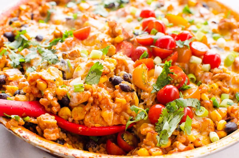 Chicken Burrito Skillet scooped with red spoon