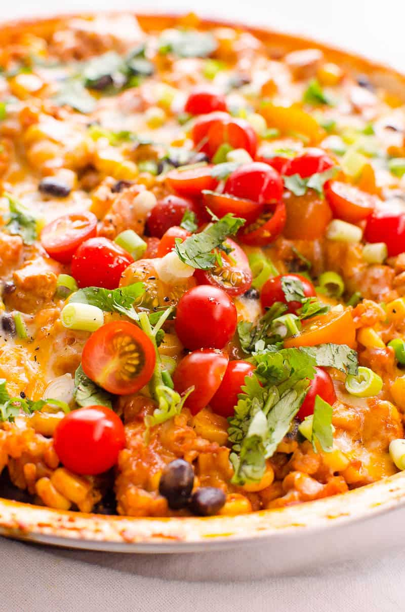 Chicken Burrito Skillet with cherry tomatoes, cilantro and green onion