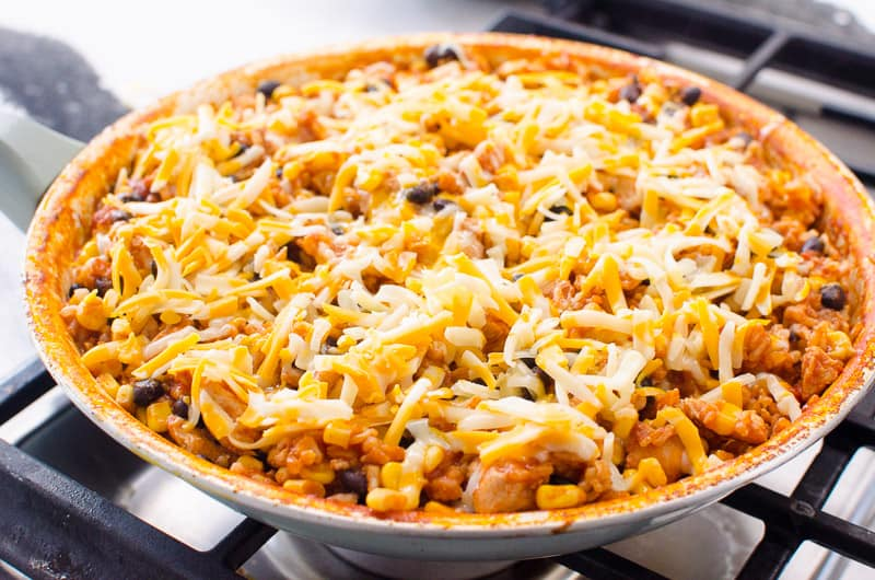 Chicken Burrito Skillet covered with shredded cheese