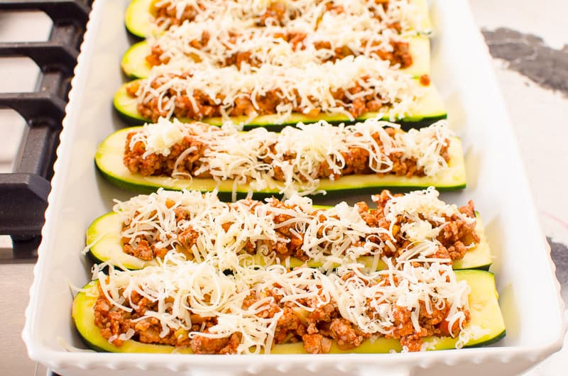 Zucchini Boats stuffed and sprinkled with cheese