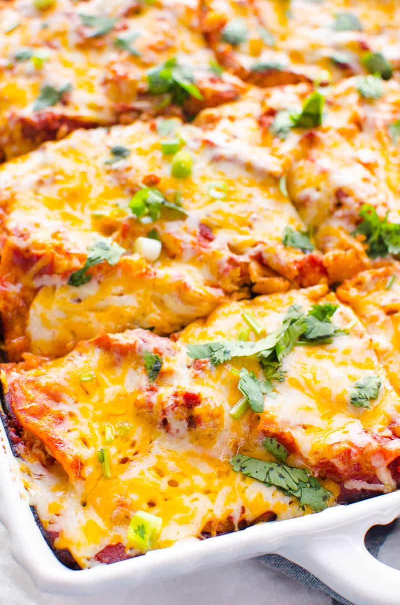 Healthy Mexican Casserole sliced in white baking dish