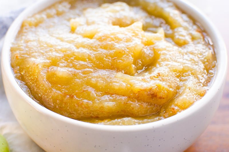 Instant Pot Applesauce in white bowl sprinkled with cinnamon