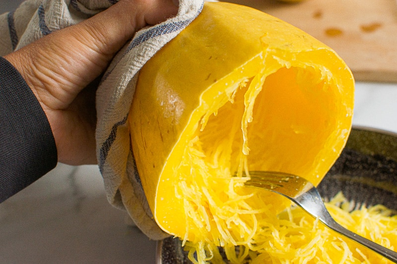 removing strands from cooked spaghetti squash with a fork