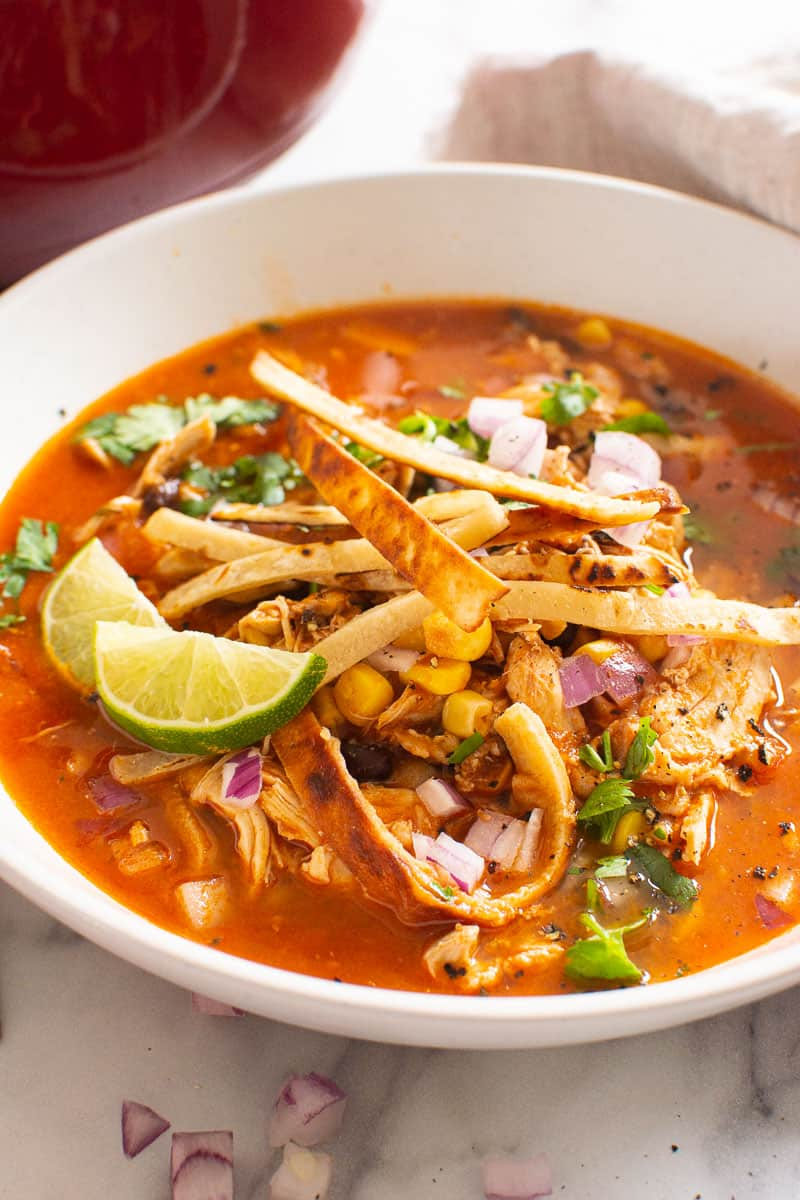 Chicken Tortilla Soup with lime and tortilla strips