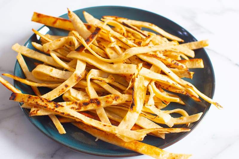 fried corn tortilla strips on green plate