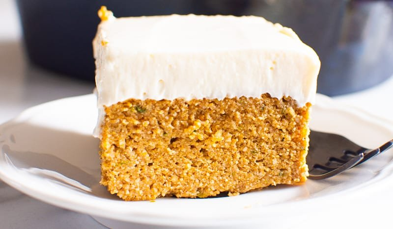 slice of healthy pumpkin cake on a white plate with a fork