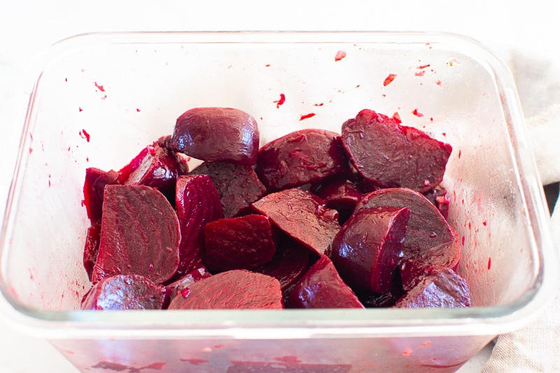 cooked sliced beets in glass container