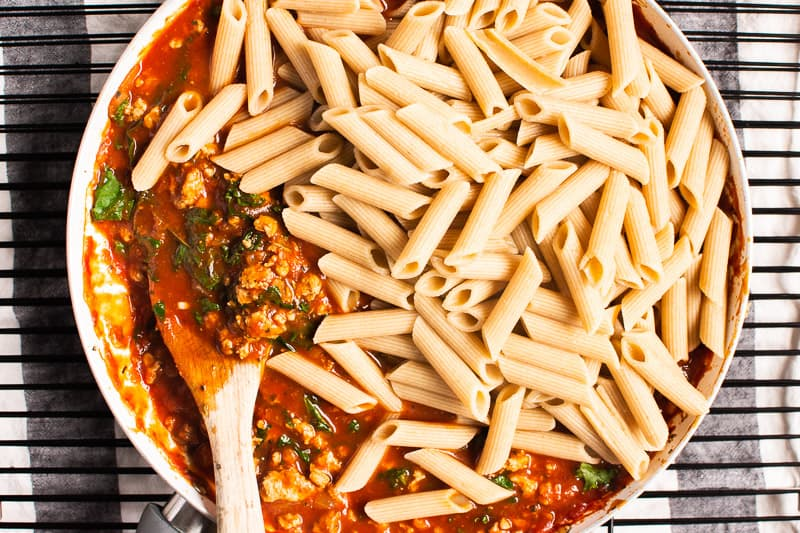 ground turkey meat sauce and pasta in white skillet