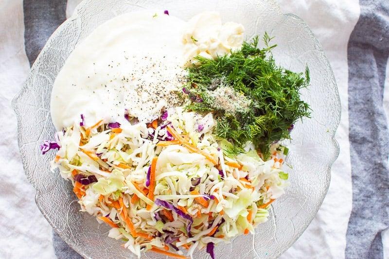 coleslaw, yogurt, mayo, dill in glass bowl on towel