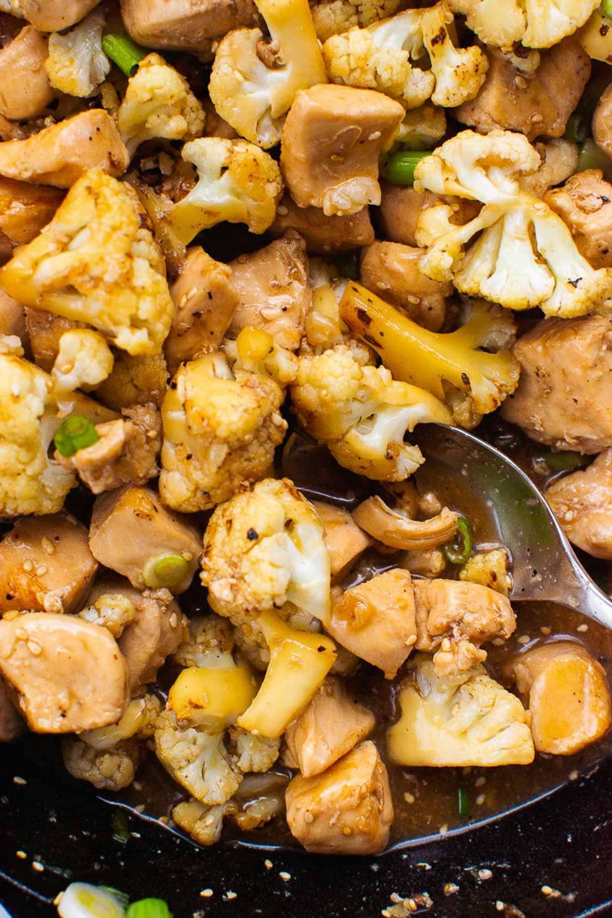Teriyaki Chicken and Cauliflower garnished with sesame seeds