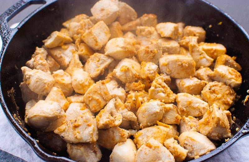 cooked chicken breast in cast iron skillet