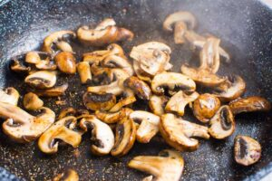 sauteed sliced mushrooms in skillet
