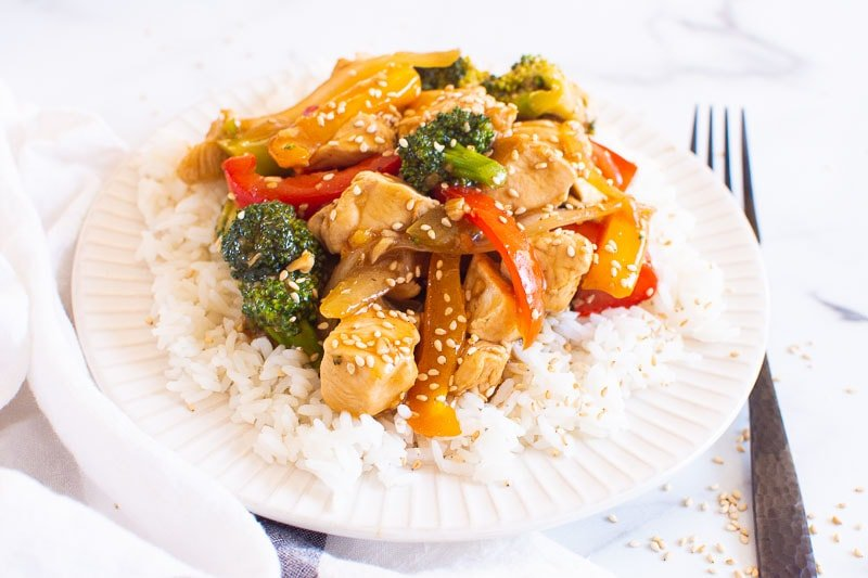 Healthy Chicken Stir Fry served on white plate with black fork