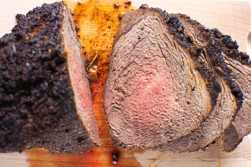 sliced sirloin tip roast on a cutting board