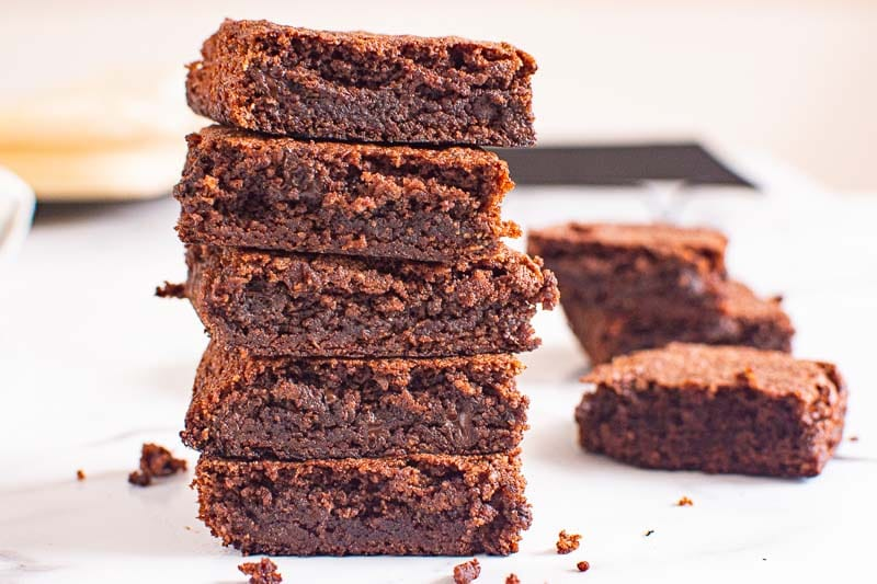five almond flour brownies stacked