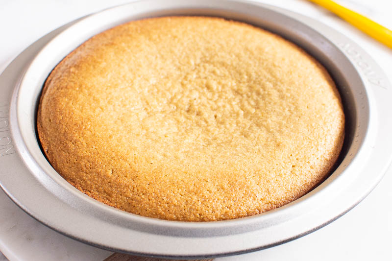 baked almond cake in a cake pan