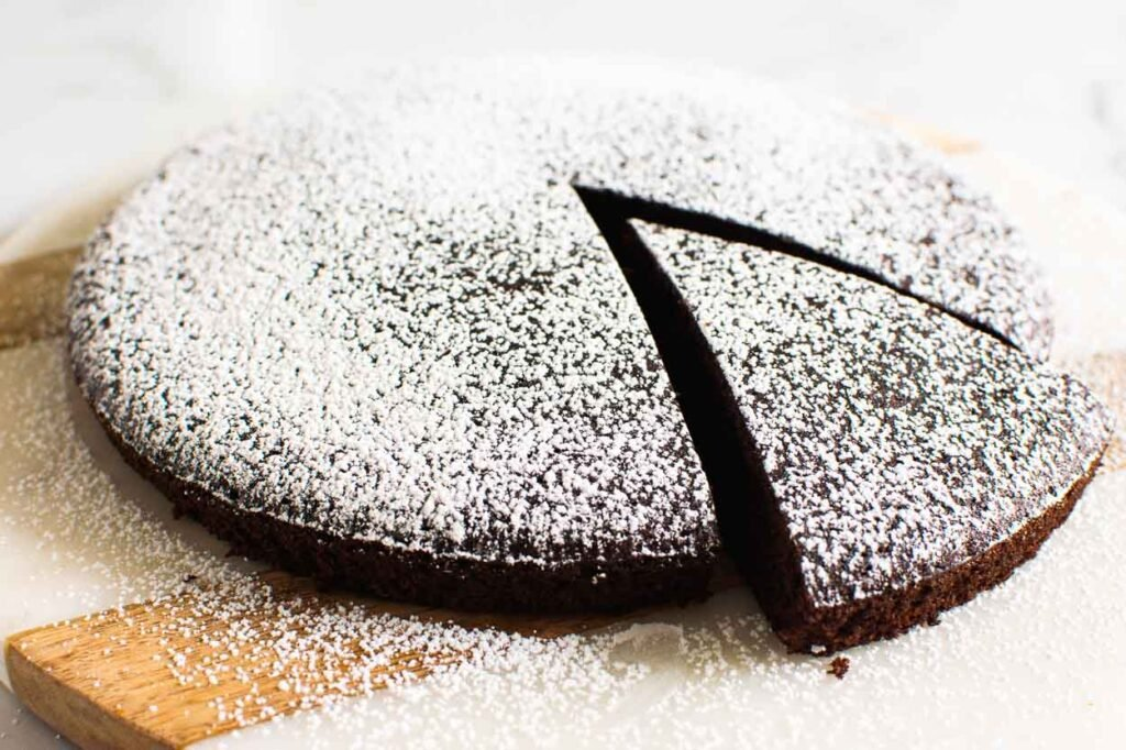 almond flour chococlate cake dusted with icing sugar and slice