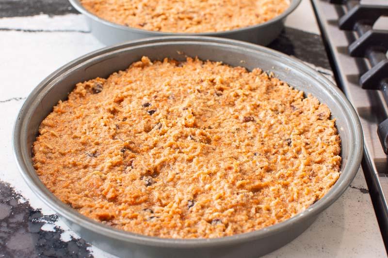 almond flour carrot cake batter divided between 2 cake pans