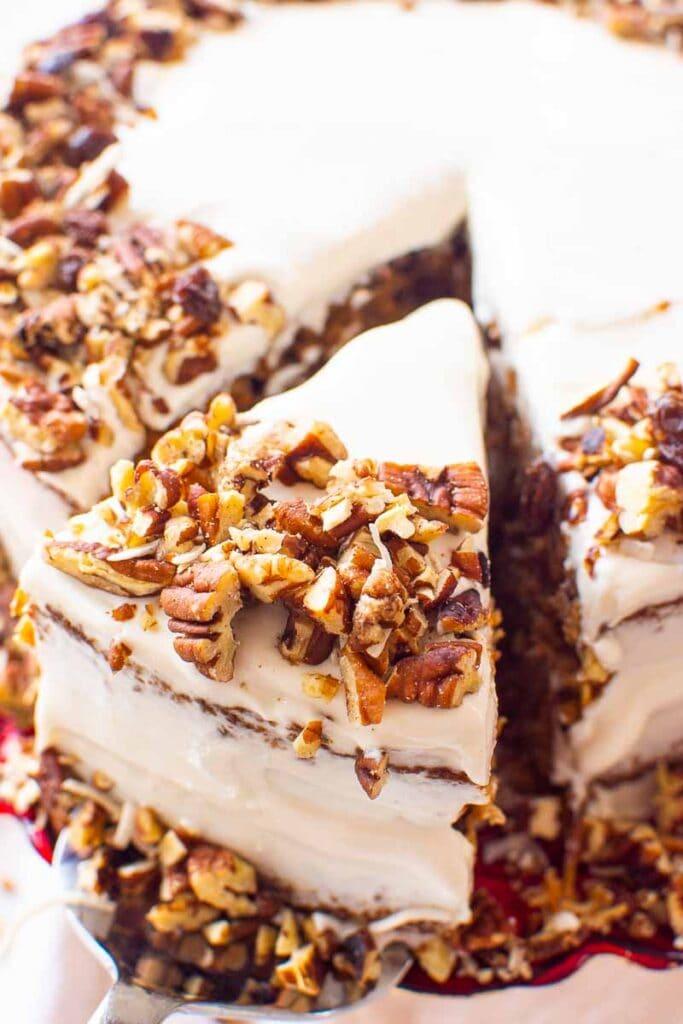 slice of almond flour carrot cake on a cake server
