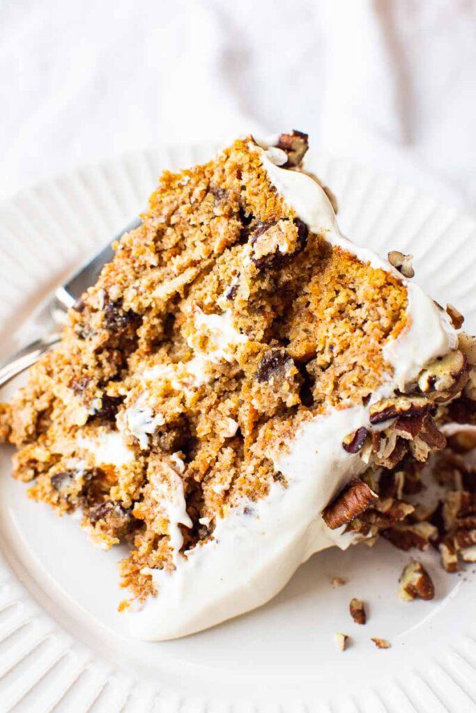 slice of gluten free carrot cake on white plate