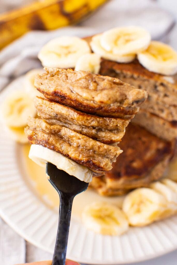 healthy banana pancakes sliced and on a fork