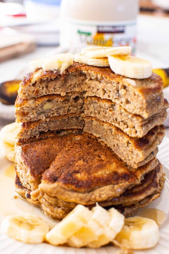 healthy banana pancakes garnished with bananas sliced into