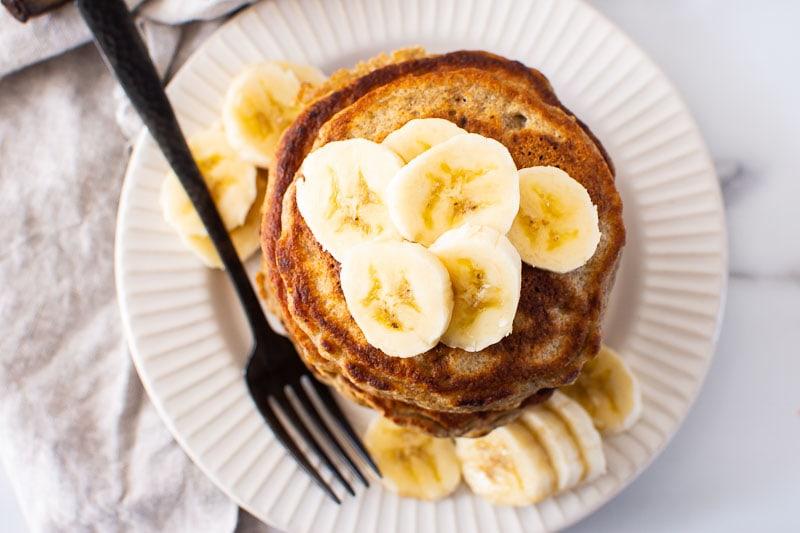 healthy banana pancake recipe served with bananas