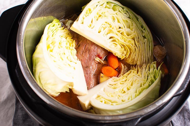 cabbage, carrots and potatoes added to cooked brisket in instant pot
