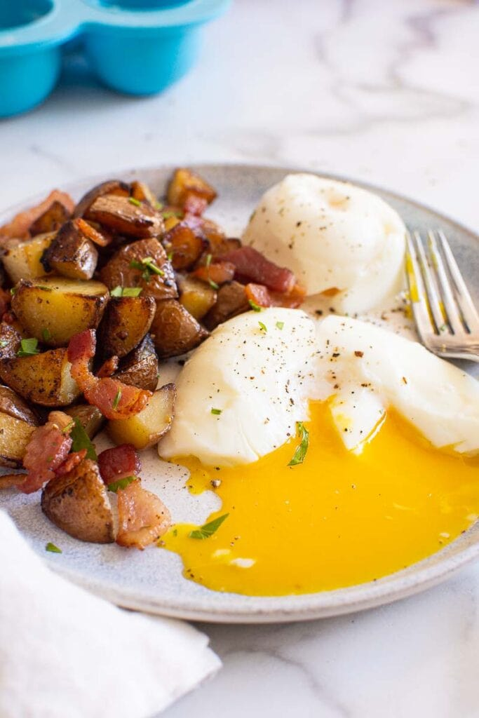 instant pot poached eggs with breakfast potatoes on blue plate