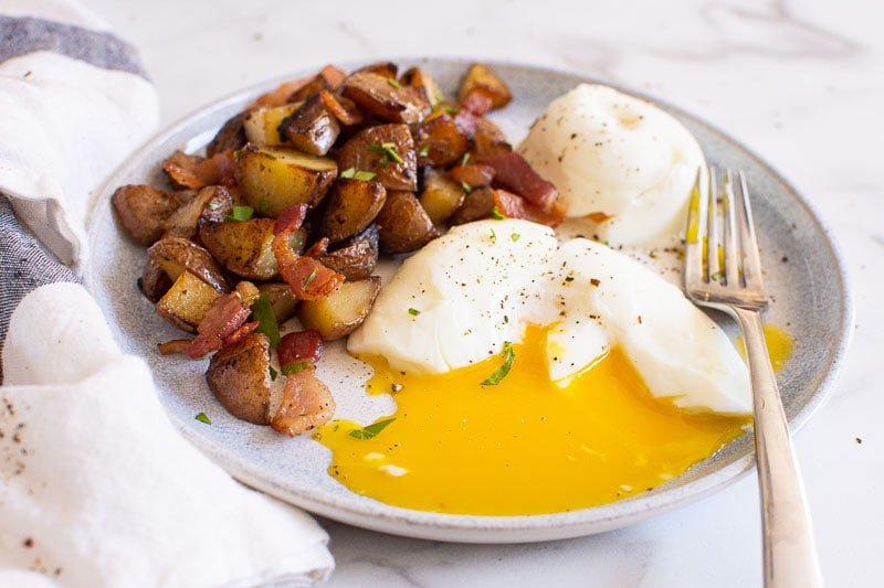 skillet potatoes served with poached eggs