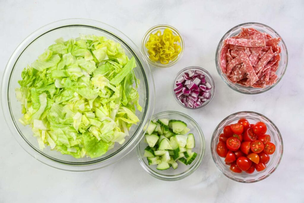 Steps to make Italian Chopped Salad, including chopping, slicing, and dicing the ingredients.