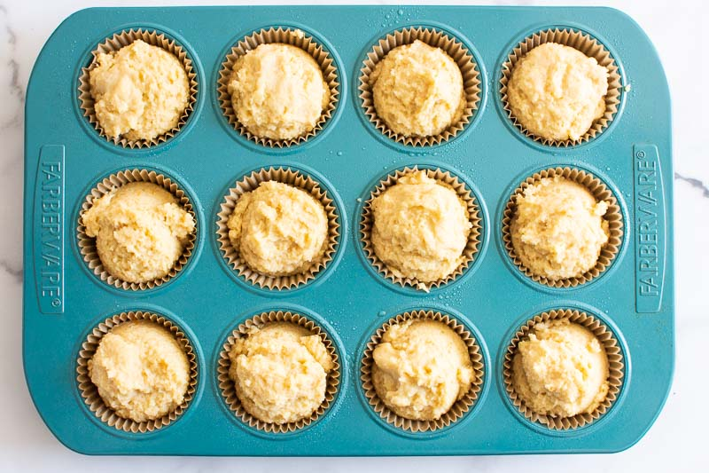 unbaked muffin batter in a blue tin