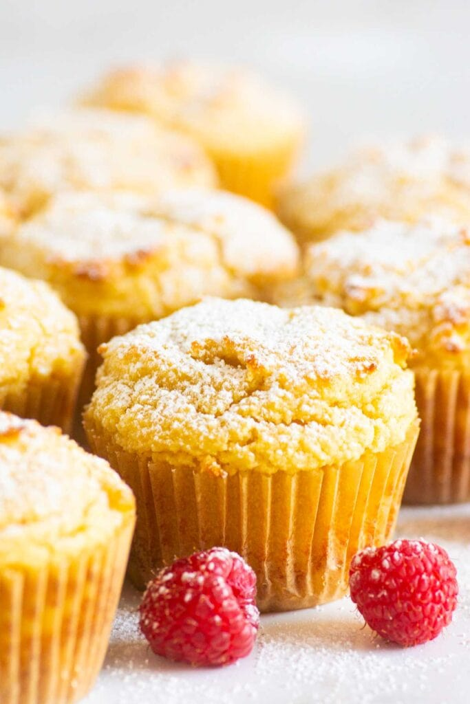 gluten free muffin dusted with icing sugar and raspberries