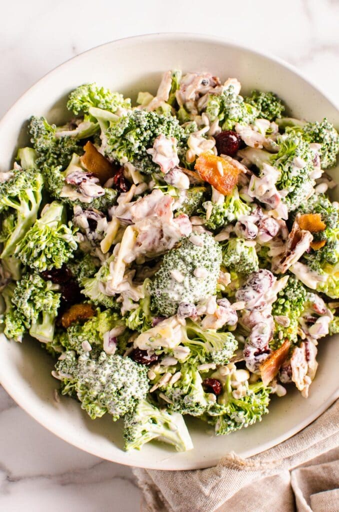 healthy broccoli salad recipe served in white bowl