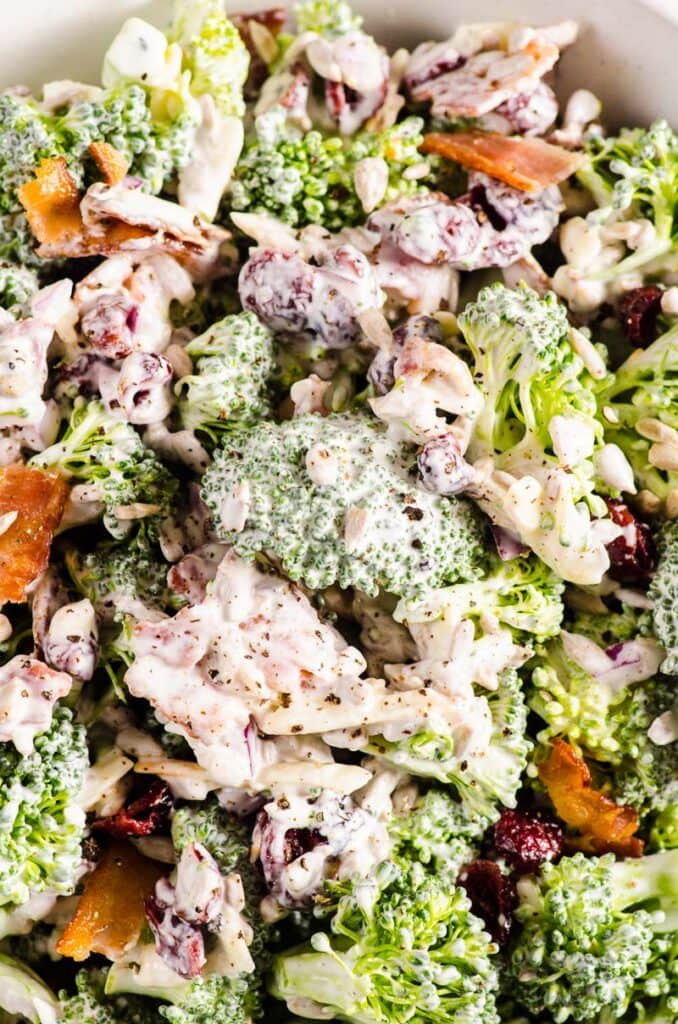 healthy broccoli salad with yogurt dressing, dried cranberries and bacon