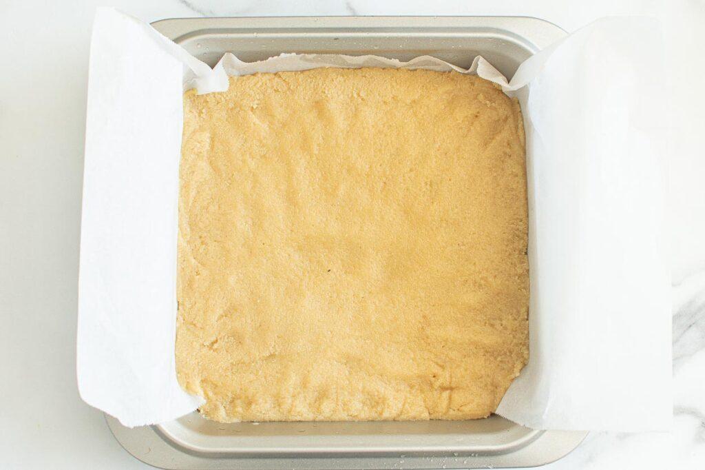 unbaked crust for lemon bars in baking dish