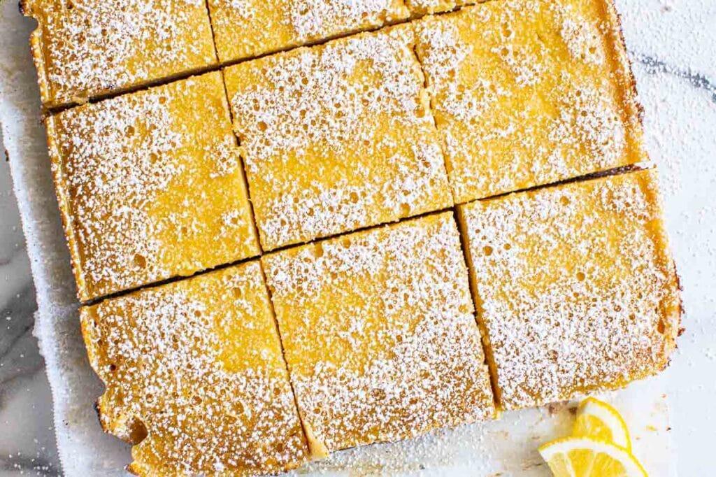 sliced lemon bars on parchment paper