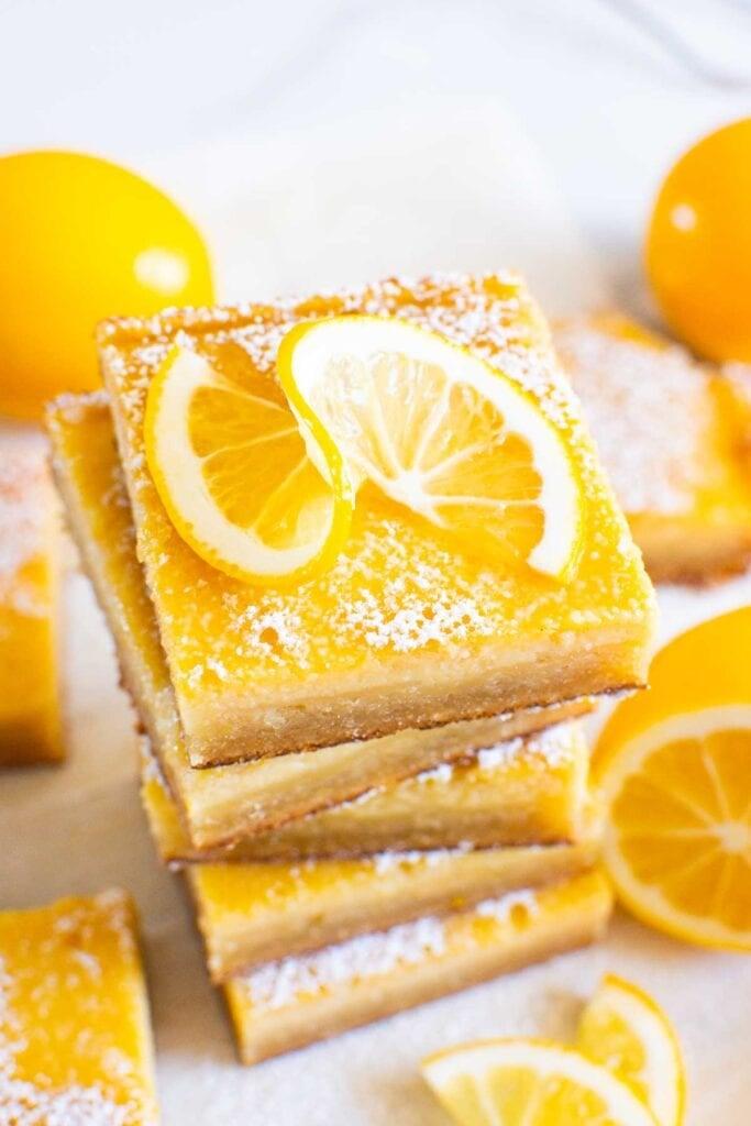 gluten free lemon bars stack garnished with lemon slice