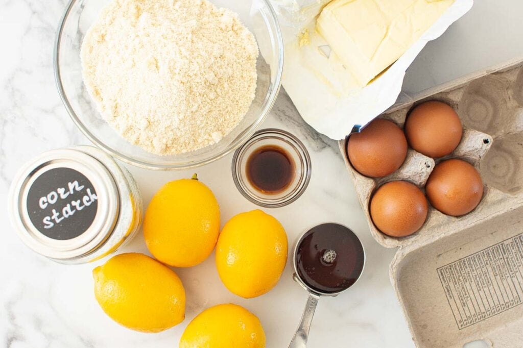 eggs, lemons, maple syrup, vanilla extract, butter, almond flour, cornstarch