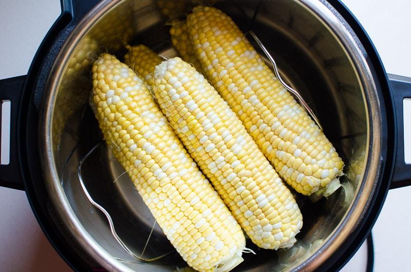 raw corn on the cob inside pressure cooker