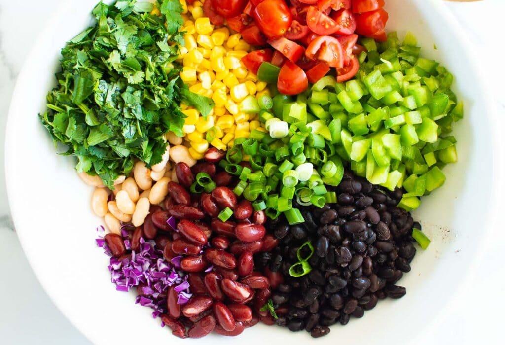 black beans, red kidney beans. tomato, white beans, cilantro, corn, bell pepper, green onion