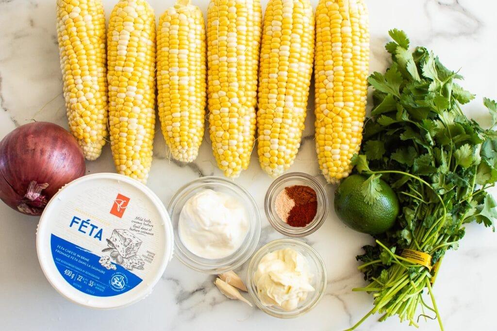 fresh corn, red onion, cilantro, lime, feta cheese, yogurt, mayo, spices