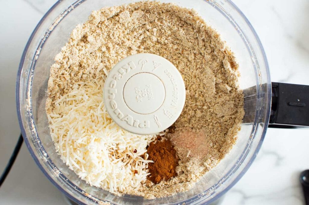 oats, coconut flakes, spices in a food processor