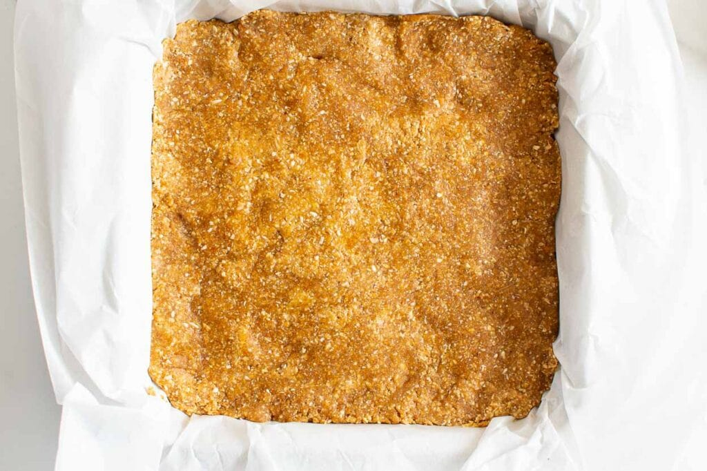 pressed peanut butter bars in baking tray