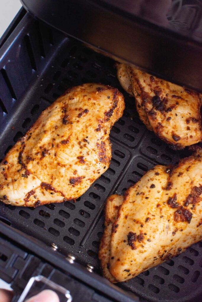 chicken breast seasoned and in air fryer