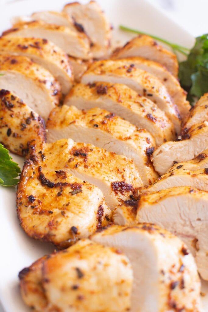 air fryer chicken breast on plate with garnish