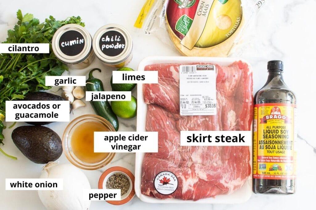 skirt steak, soy sauce, acv, garlic, cilantro, jalapeno, tortillas, onion, limes, spices